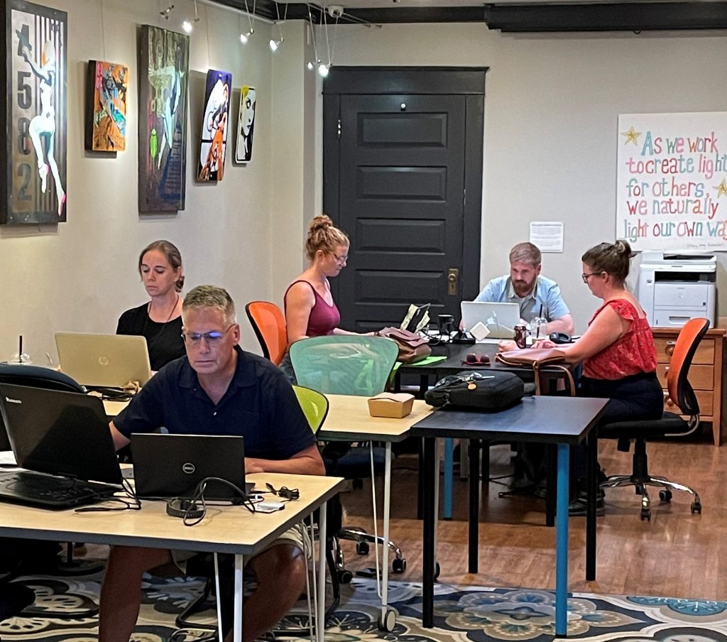 people working on their laptops at Cowork Frederick