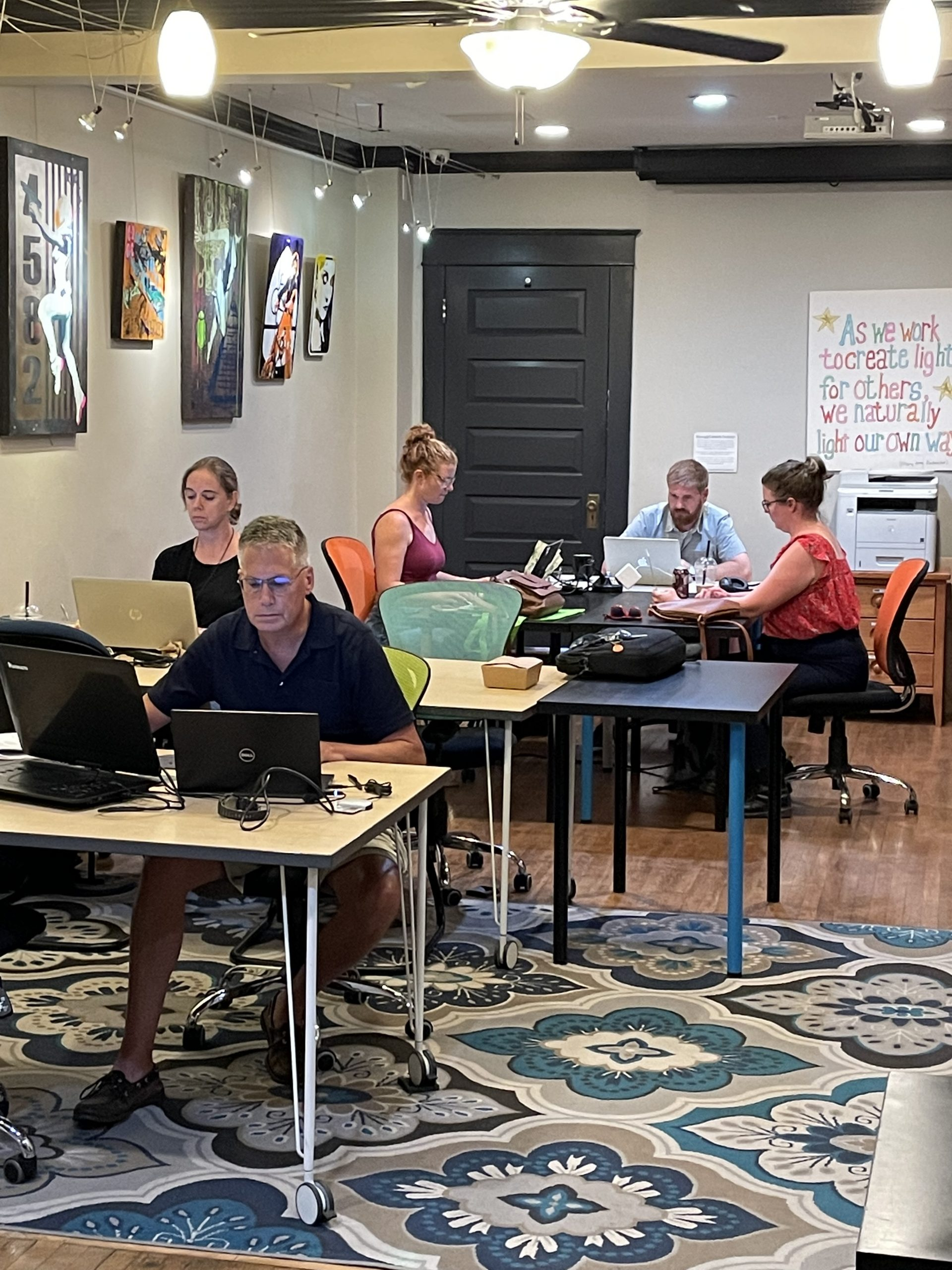 people working at tables on their computers